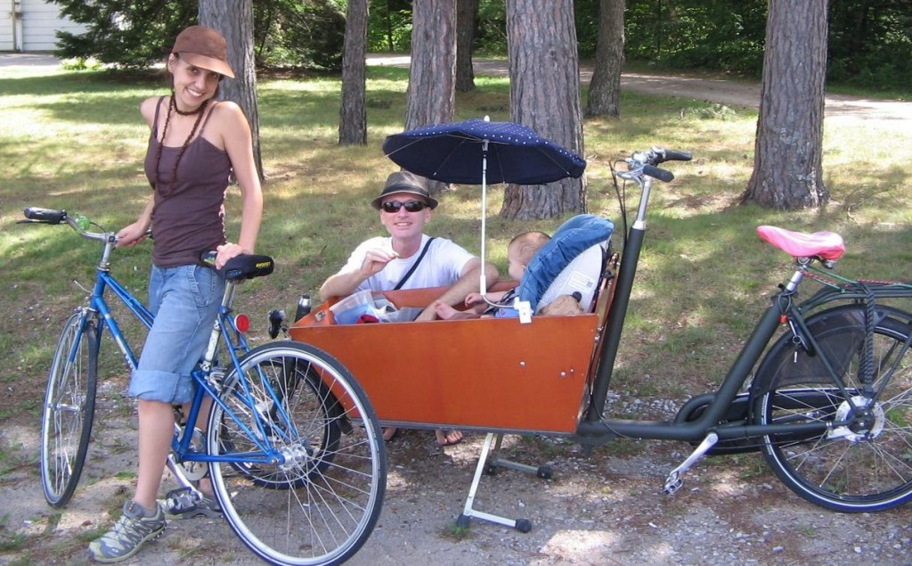 Toronto family relaxing on a northern adventure with a babe to go in a Dutch cargo bike.