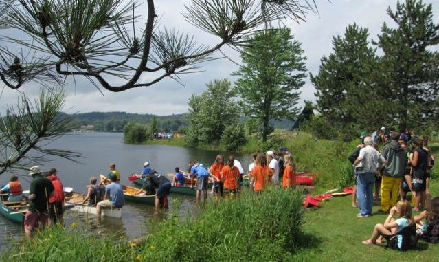 Annual summer camp canoe challenge in Head Lake, Haliburton Village.